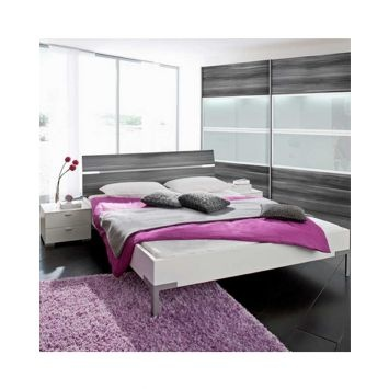 The Choice Bed is a hip, contemporary piece of bedroom furniture that comes in pure white with a grey walnut headboard. The look is completed with chrome legs, giving the piece a sense of luxury. It is scratch resistant, durable, tough and easy to clean. Its simplicity makes it versatile and easy to coordinate with other bedroom sets. Excludes mattress and slats.