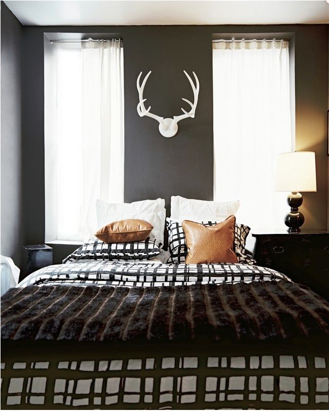 Masculine bedroom www.lonnymag.com... Or switch to pink wall paint and feminine the antlers, lol.