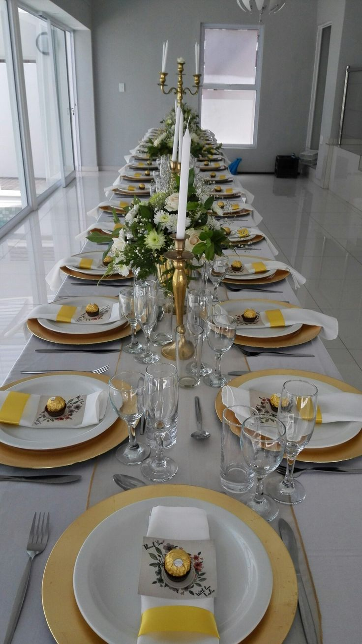 White, gold and greenery. gold charger plates. gold centrepiece ideas.