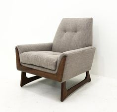 """Beautiful, Mid-century-style lounge chair featuring a walnut wood frame and gray tweed upholstery. Dimensions: 34 1/2""""""""H x 32 1/2""""D x 31 1/2""""W; Seat Height: 18 1/2""""; Seat Depth: 21"""" White Glove shippi"""