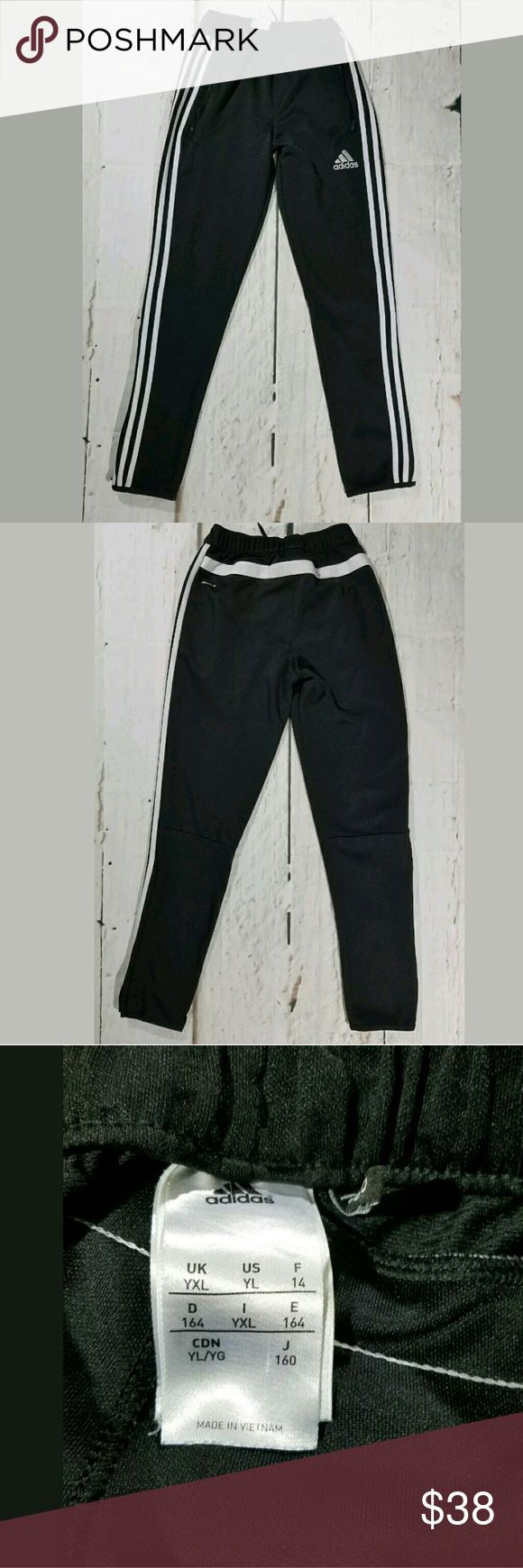 Kids Adidas Skinny Ankle Zippers Jogger Sweatpants Kids Adidas Skinny Ankle Zippers Jogger Sweatpants Black White XL   Excellent used condition.  Elastic /Drawstring waist with lots of stretch. 38 inch hips. 10.5 inch rise. 29 inch inseam.  LB Adidas Bottoms