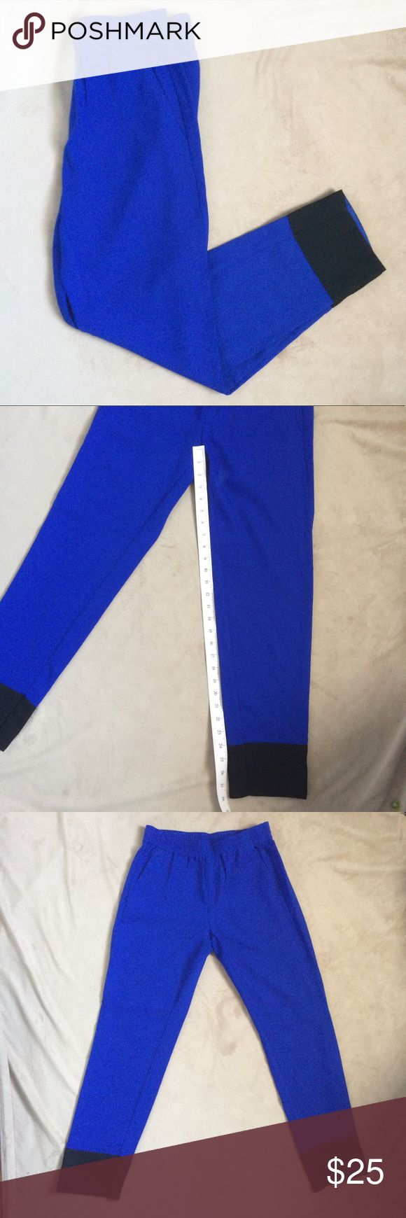 "Banana Republic Crop Trouser sz 2 EUC, these trousers are in a vibrant colbalt blue color with black trim. Cropped style works with flats, heels, or even sandals in summer. Two front pockets and two back pockets. Elasticized waist is about 2"" thick so it will add definition without digging in. Fully lined inside. Approximately 14"" across at waist and 28"" inseam. 100% polyester. Banana Republic Pants Trousers"