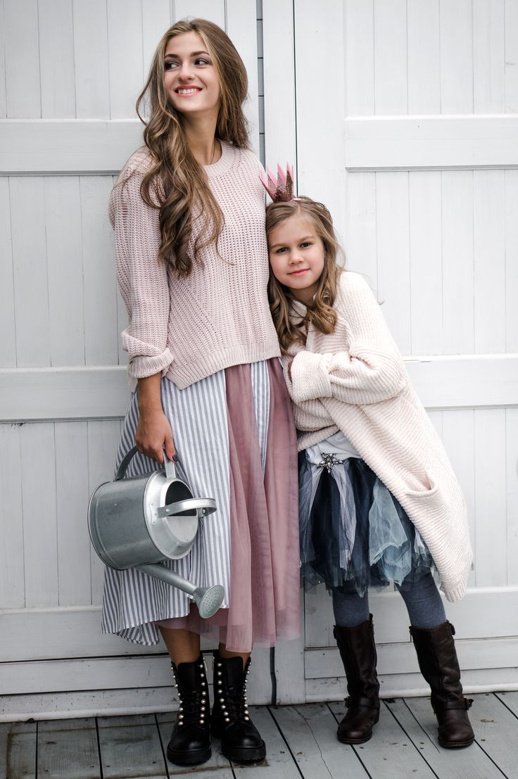 Family photography. Two sisters wearing tulle skirt in the garden. Autumn dusty pink mood