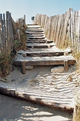Sandy Stairs between the sand dunes at the beach by the sea