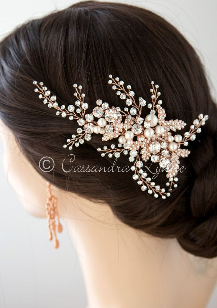 This gorgeous bridal headpiece is a spray of rhinestones, jeweled leaves and ivory pearls. It is elegant and dramatic! On a pinch style clip it is about 5 inches long and 2.5 inches high. Available in