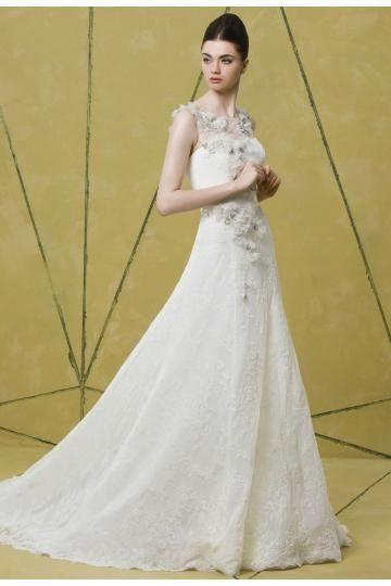 Robe de mariée en dentelle orné cristaux et fleurs col rond