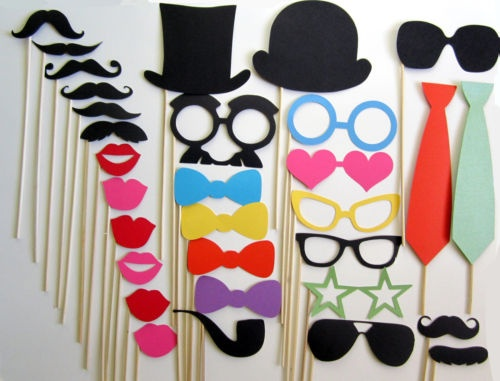 """Make some fun props for a """"photo booth"""" (could just be a nice backdrop + volunteer with a camera + instant printer) at the event. Charge $5 per picture. This let's everyone take a fun memory home. It helps set a silly vibe and fun atmosphere at your event. :) Photo by propsonsticks on ebay."""