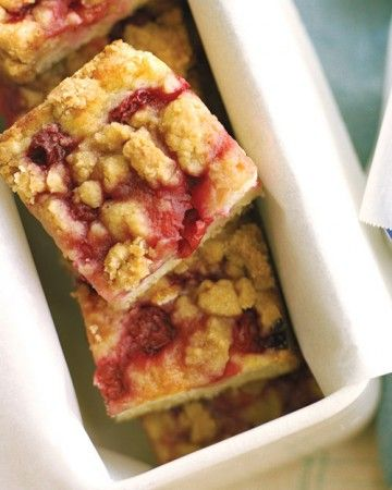 This picnic-perfect handheld dessert combines tender buttermilk cake dotted with fresh sour cherries, topped with a sweet cinnamon-kissed crumble.