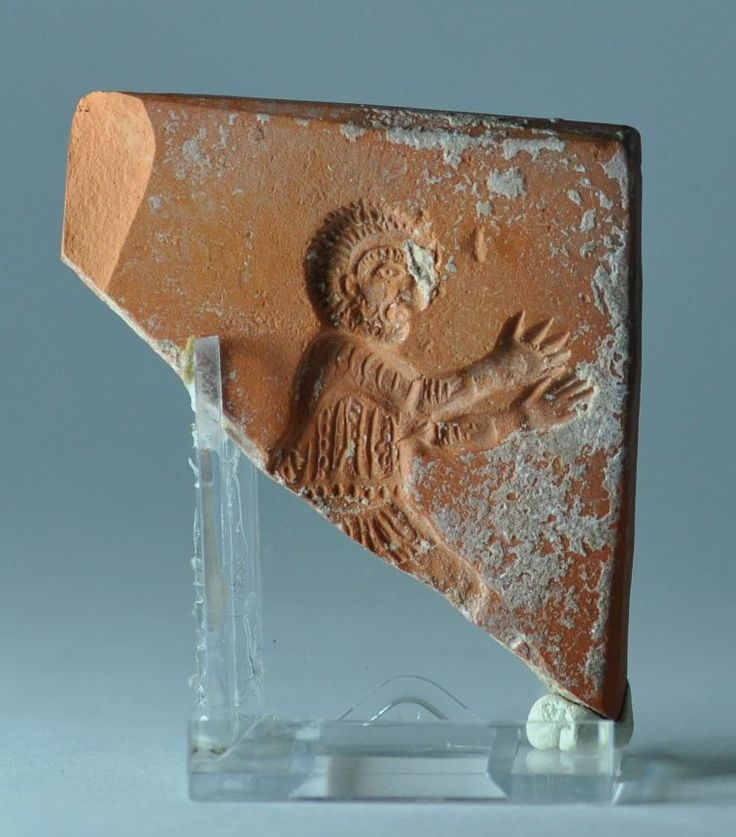 Roman terra sigillata mould, 4th-5th century A.D. African red slip ware mould, North Africa, with man with raised arms, 5 cm high. Private collection