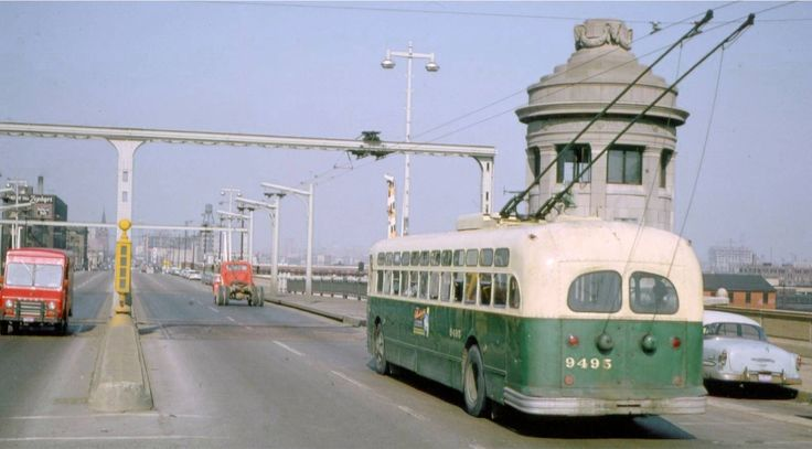 At first I thought it's a Russian-made Trolley-Bus in Sofia, picture taken about 1955. Nope. It's in Chicago, bus is of course American, and pic is later ; via http://chuckmancollectionvolume12.blogspot.ch/2013/01/photo-chicago-cta-trolley-bus-on-bridge.html  http://chuckmancollectionvolume12.blogspot.ch/2013/01/photo-chicago-cta-trolley-bus-on-bridge.html