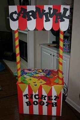 DIY carnival booth made out of a cardboard box + multiple wrapping paper tubes