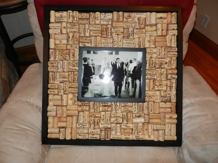 Alternative guest book...guests sign corks then you glue them into a frame, or make trivets out of them