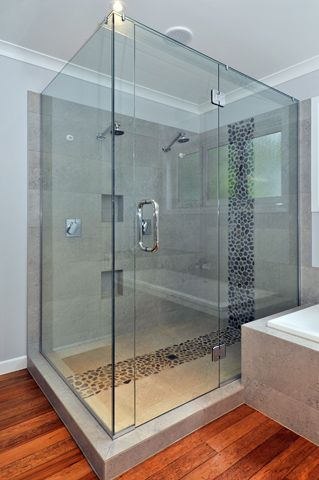 Double shower with natural stone feature tile insert