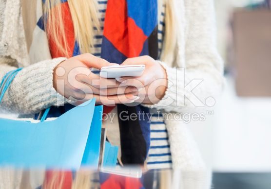 Shopping woman using a Smartphone royalty-free stock photo