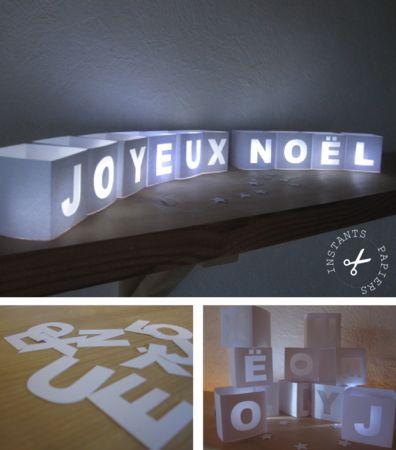 Fabriquer des photophores Joyeux Noël. Le gabarit est à imprimer gratuitement, puis à découper et déposer une bougie led pour l'éclairer