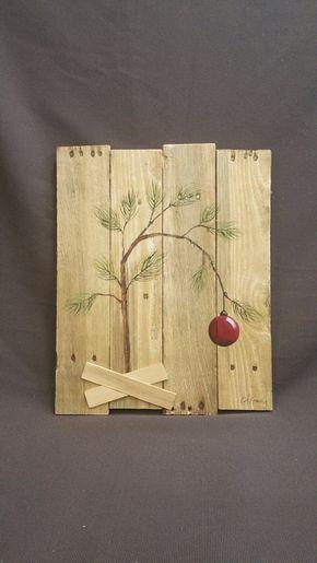 À la main panted décorations de Noël, arbre de Noël de Charlie Brown, Snoopy, Peanuts, palette de récupération wall Art, cadeau de Noël, rustique Shabby Vous aimez le Charlie Brown Christmas ? Voici une décoration de Noël unique à ajouter à votre maison ! Peinture acrylique sur bois de palettes récupéré, avec des lattes de bois mince pour la base de l'arbre. Cette pièce est 17 po x 13 po. Toutes mes créations sont faites de planches de récupération. Ils sont peints à la main et sont fait...