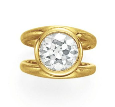 A DIAMOND RING Bezel-set with an old European-cut diamond, to the bifurcated hoop, mounted in 18k gold