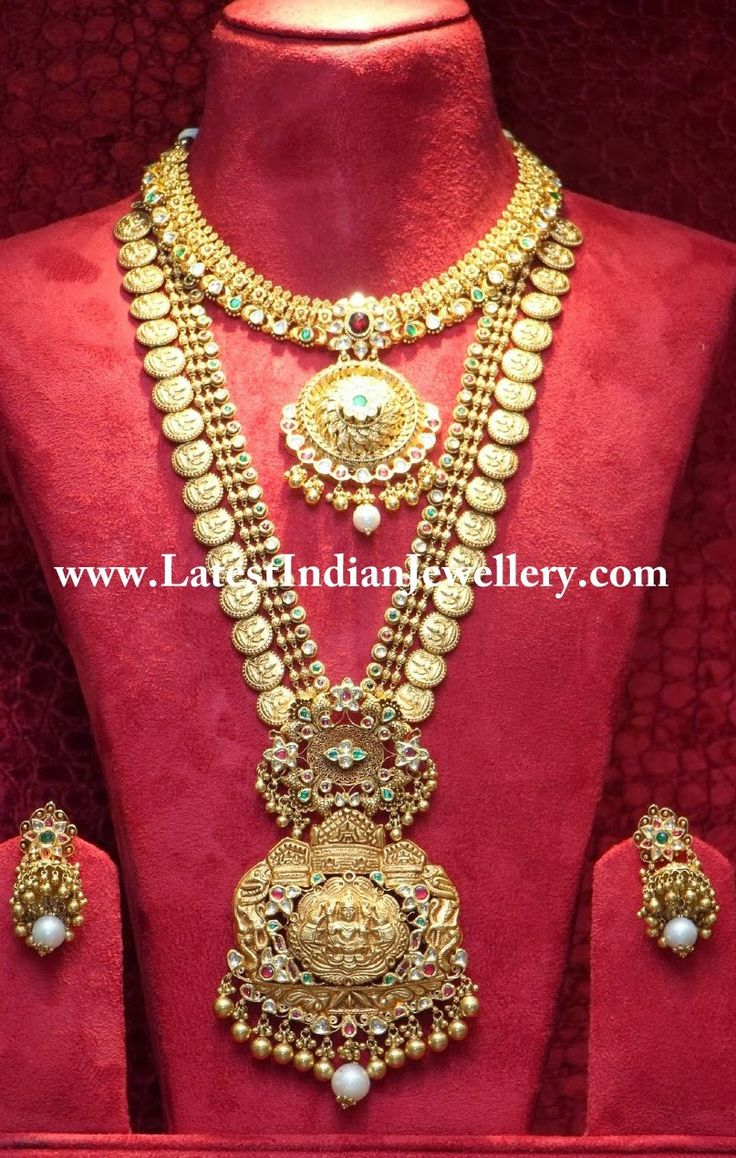 Antique designer kasumala long necklace fused with small kundans in white, red and green colors. Beautifully crafted double step gold pendant embossing small Lakshmi motif in the center with gold ball droplets is the highlight of this bridal piece.