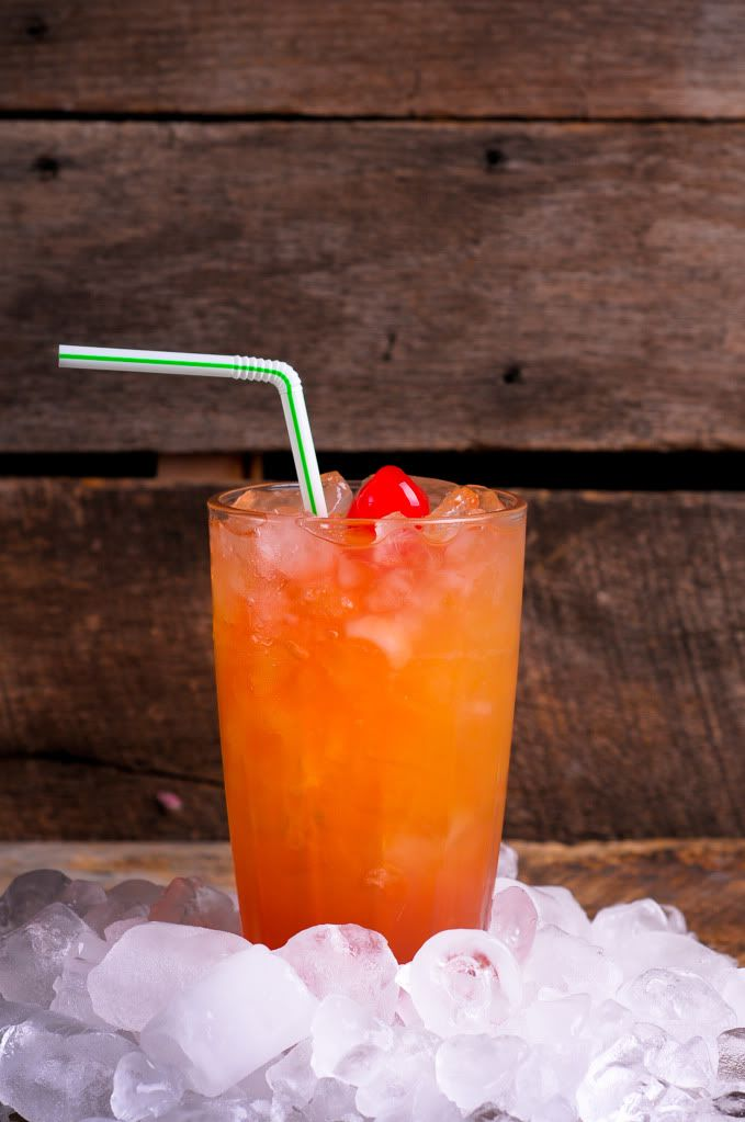 Tootie Fruity: 1 ounce vodka 1/2 ounce triple sec Equal parts grenadine (or cranberry juice!), orange juice, and pineapple juice Garnish with a cherry