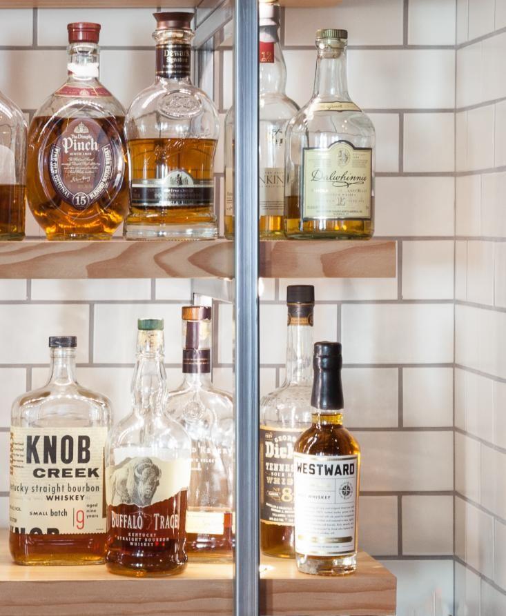 dalwihhnie is my favorite scotch hock farm restaurant bourbon on display remodelista - Farmhouse Restaurant Ideas