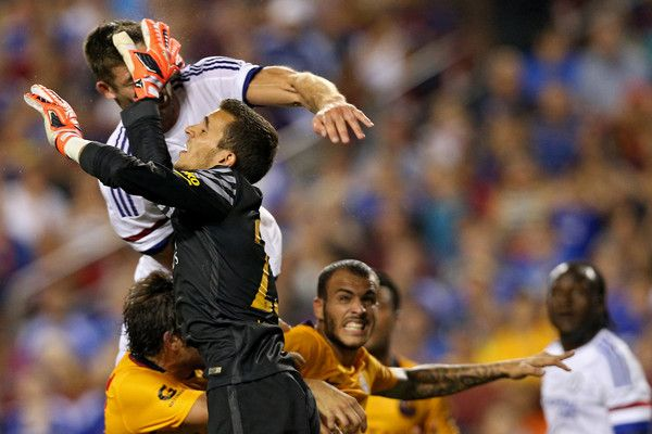 Gary Cahill #24 of Chelsea scores on a header as he is hit in the face by goalkeeper Jordi Masip #25 of Barcelona in the second half during the International Champions Cup North America at FedExField on July 28, 2015 in Landover, Maryland. Chelsea won in a penalty shootout.