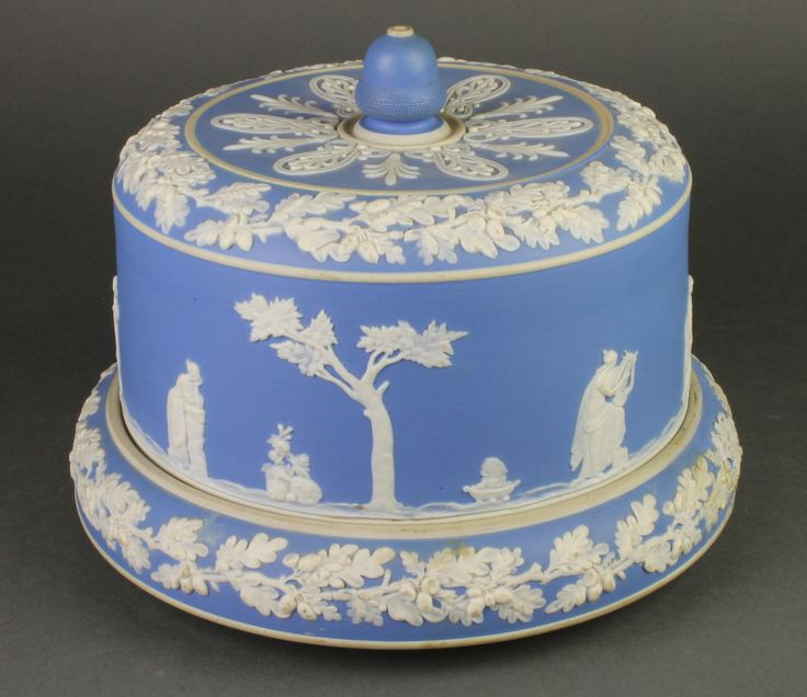 """Lot 82, A Victorian blue Jasperware cheese dome and stand decorated with classical figures and scrolling acorns 11"""", est £40-80"""