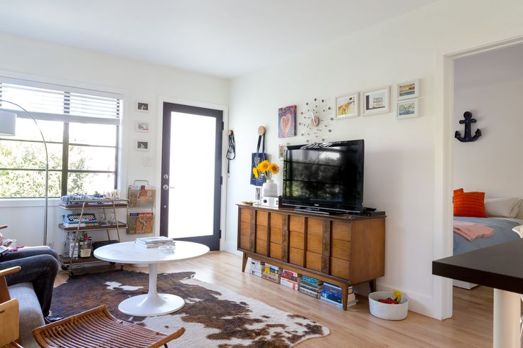 Much of the couple's furnishings are a mixture of Craigslist finds and affordable modern pieces. The Mayan lowboy dresser was found at Hutch. The anchor marquee in the bedroom is from Target.