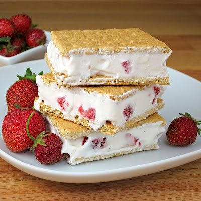 Lite Cool Whip  chopped strawberries, mixed together,  spread between graham crackers, then frozen.