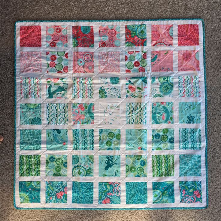 Another basic baby quilt using the Coral Queen of the Sea collection