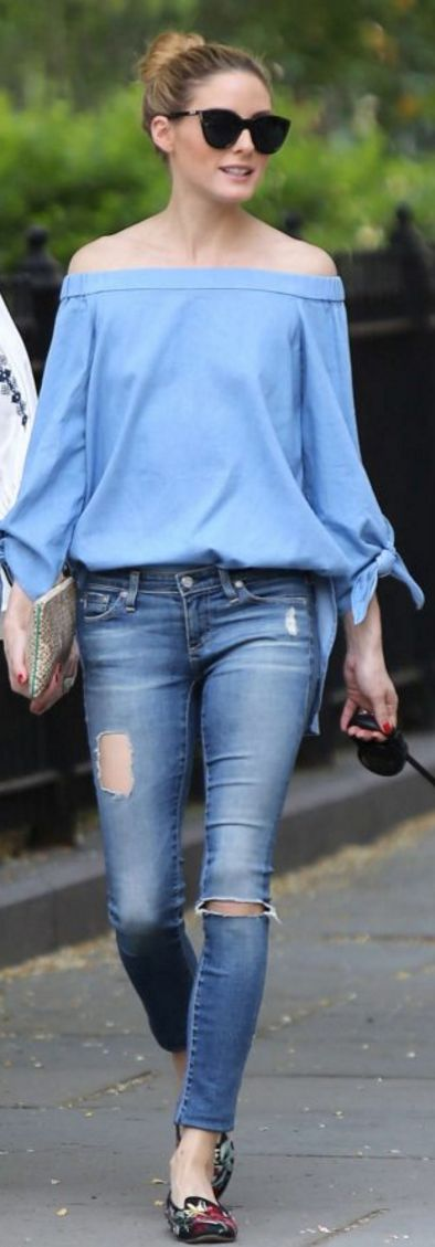 Who made  Olivia Palermo's blue off the shoulder top, black sunglasses, and floral print shoes?