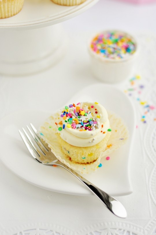 This is the best vanilla cupcake recipe I've found to date!  So fluffy, moist and just plain yummy:)