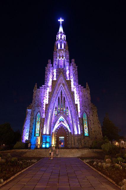 Nossa Senhora de Lourdes Cathedral glowing in the night, Canela, Brazil (by hoeper).