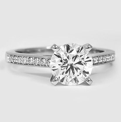 This delicate and exquisite diamond engagement ring features a sparkling row of petite pavé diamonds in a platinum setting. #BrilliantEarth