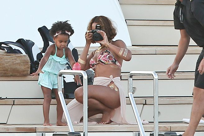 , Beyoncé then took Jay Z and her flash tattoos to meet up with Blue Ivy for an adorable photo shoot on their yacht. Because you can't make this stuff up, and it's the Carters' world, and we're just living in it.
