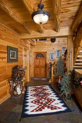 Log home entryway decorated for Christmas