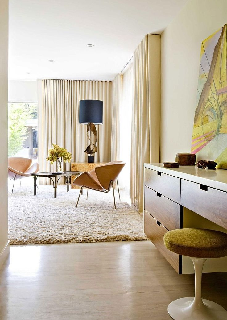 Los Angeles' Brentwood Residence was designed by Jamie Bush & Co. for a former studio head. It is characterized by a stylish mix of mid-century pieces.