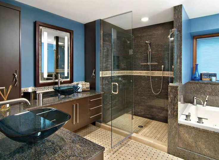 Inspiration Web Design Blue glass vessel sinks highlight this decidedly masculine bathroom Blue walls bine with earth toned marble to create a super sophisticated bath