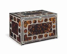 Description: A FINE INDO-PORTUGUESE TORTOISESHELL AND IVORY-VENEERED FALL-FRONT CABINET NORTH-WESTERN INDIA, 17TH CENTURY Of rectangular form, the decoration to each side, front and back arranged around a central gilt-foiled tortoiseshell panel, bordered with bands of ivory and possibly ebony micro-mosaic interlocking to form polygons, each side framed with bands of triangular panels of mother-of-pearl the front. (28 x 44.7 x 31.8cm.)