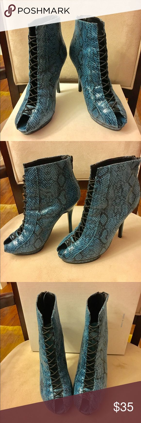 "NWOT Shoe Dazzle Snakeskin Lace Ankle Boots Brand New. Never been worn Shoe Dazzle faux snake skin ankle boots.  You will look hot in these sleet looking ankle boots. Lace detail on the front.  Approximately 4.5"" heel. 1 inch platform.  Don't miss out on this one-of-a-kind shoe!! Shoe Dazzle Shoes Heeled Boots"