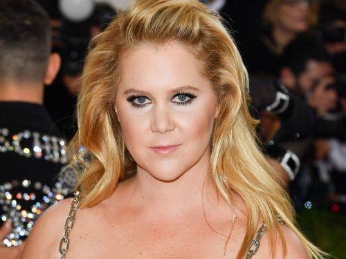 Amy Schumer celebrated the 4th just like you did — in a bikini... (looking fantastic, and) complete with a fuck you to body shamers