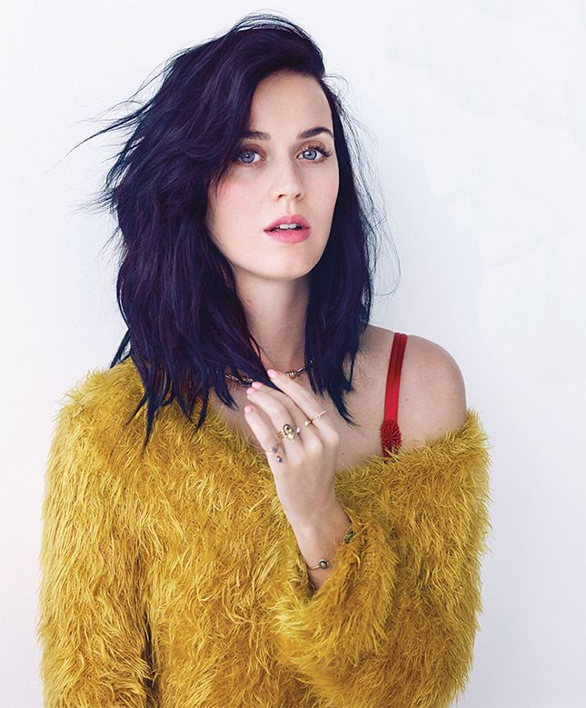 Copy Katy Perry's shoulder length style by keeping layers minimal throughout the cut and opting for some long, face-framing bangs around the face.
