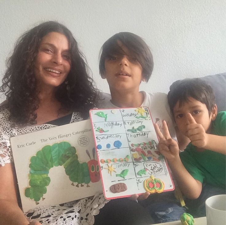 """Practising English literacy with a classic """"The Hungry Caterpillar"""" and then """"rewriting the book"""" with modelling clay before narrating the story once again"""