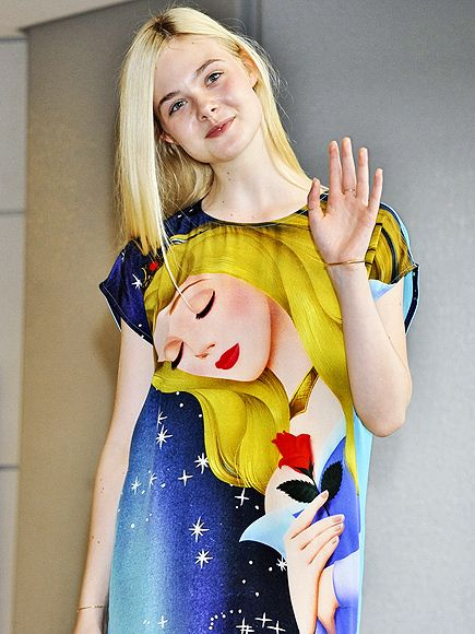 Star Tracks: Monday, June 23, 2014 | A Beauty to Behold  | Talk about staying in character! Maleficent star Elle Fanning wears a Sleeping Beauty dress as she arrives at Japan's Narita International Airport on Friday.