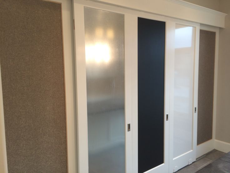 Hidden closet with cork, magnetic, chalk and dry erase boards! Brilliant! #mcewancustomhomes #details