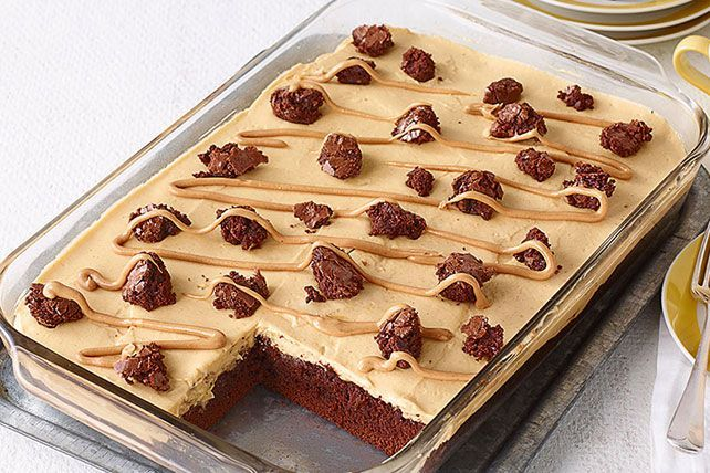 Brownies get the poke-cake treatment in this scrumptious dessert—and are filled with a creamy mixture of peanut butter and vanilla pudding.