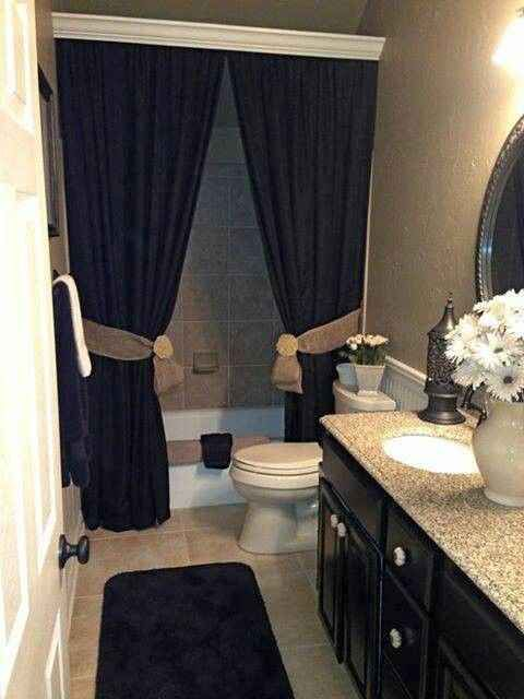love the idea of these bold dark curtains in my bathroom to make it look more luxurious ! I really like the crown molding in front of the curtain rod