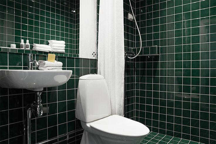 I am drawn to white tilings, but it seems one tone green tiles works in the bathroom too // Fantastic Frank