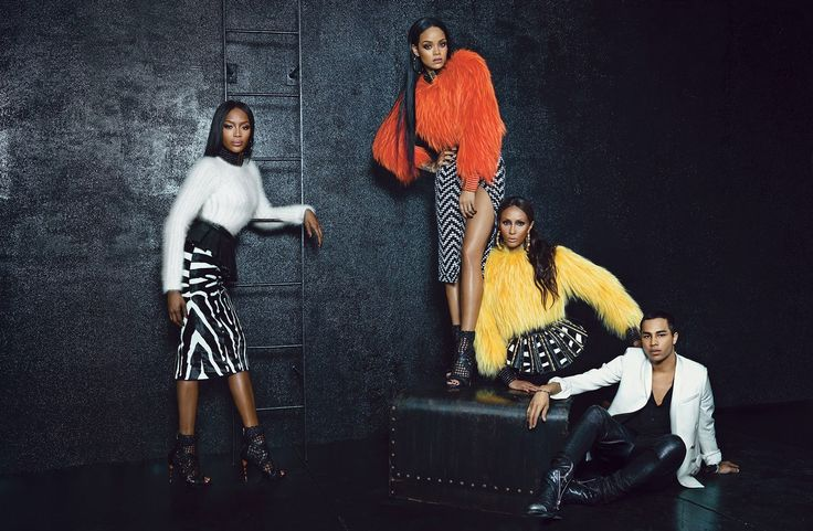 Naomi Campbell, Rihanna, and Iman wear Balmain clothing, jewelry, and shoes (throughout). Designer Olivier Rousteing wears his own clothing. All by Balmain. All available at Barneys New York, New York, 212.826.8900. Sweater, $1,300, belt, $2,390, skirt, $700, earrings, $800, choker, $3,330, and boots, $3,000. Sweater, $6,700, belt, $2,900, skirt, $3,750, earrings, $800, choker, $3,330, bracelet, $2,910, and boots, $3,000. Sweater, $6,700, belt, price upon request, skirt, $1,200, earrings…