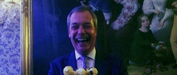 Nigel Farage, the interim leader of the United Kingdom Independence Party (UKIP) holds a platter of Ferrero Rocher chocolates during a party in London, Britain, November 23, 2016. REUTERS/Guy Faulconbridge