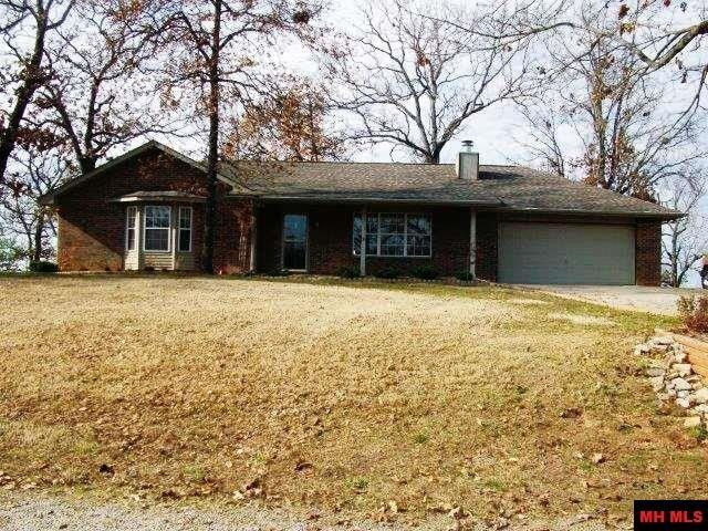 All the comforts of home come with this 2 BR, 2 BA home close to Mountain Home & Lk Norfork. Property inside features wood burning fireplace in LR, spacious BR's with walk-in-closets & all appliances convey, carpet cleaned 2018. Outside there are two storage buildings, garden spot, view of pond, Ozark Mountains view in the back and an extremely nice wooden deck restrained 02/02/18 for cookouts with family and friends. Great Price, Great Location & Great Value. Property is located in Mtn Home…